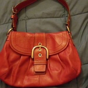 Red patent leather Coach bag,